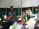 AJ Dewey, Class of '04, and John Suszko serve beverages.