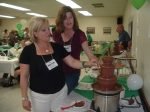 Mary Ellen McCauley Sierhuis '79 and Jennifer Ellam Starsinic '79 test out one of the chocolate fountains.