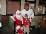 Alumni having fun in the community!  Santa is Herb Wragg '58 and his elf is Jeff Hoachlander '74