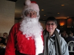 Betty Miller '63 is all smiles with Santa.