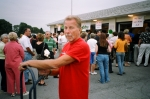 Herb Wragg, Class of '58, lends a hand with moving supplies and drinks from the school cafeteria to the football field.