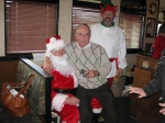 Bill Drake '58 gives Santa his Christmas list.