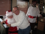 Sam Potteiger '58 having fun with Santa!