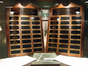 The 'perpetual plaque' in the CDHSAA display case lists the names of all scholarship recipients.